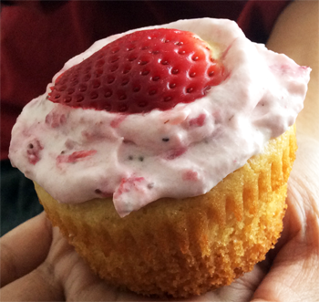 Vanilla Cupcake Topped with Fresh Strawberry Cream