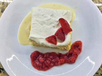 Tres Leches with Cream and Strawberry Sauce